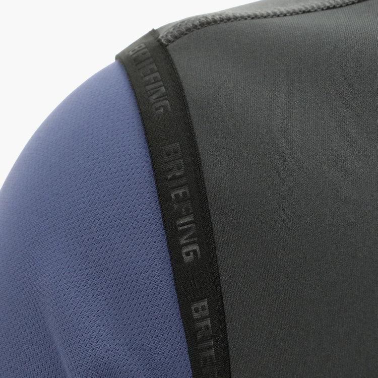 袖ぐり、裾部分にBRIEFINGロゴ入りのパイピングをあしらった技ありのデザイン。